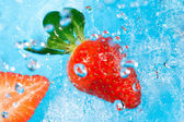 Strawberry splash in water- top view — Stock Photo