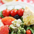 Fresh cheese salad with rocket and berrys — Stock Photo