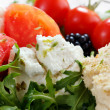 Stock Photo: Close up of fresh cheese salad with rocket and berrys