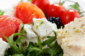 Close up of fresh cheese salad with rocket and berrys — Stock Photo