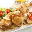 Dish of two roasted chicken legs isolated on white — Stock Photo