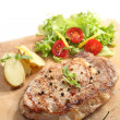 Beef cooked on a stone - traditional portuguese cuisine — Stock Photo #16324435