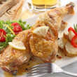 Dish of two roasted chicken legs — Stock Photo