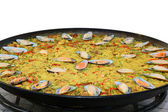Paella being cooked isolated on white — Stock Photo