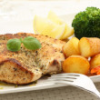 Roasted chicken breast with potatoes — Stock Photo