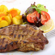 Beef chop with aromatic butter sauce - Stock Photo