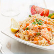 Постер, плакат: Dish of seafood rice with salad