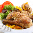 Dish of roasted chicken legs — Stock Photo