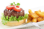 Big burger wih fries isolated on white — Stock Photo