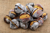Coal roasted chestnuts - portuguese traditional autumn snack-str — Stock Photo