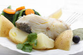 Boiled cod fish with potatoes and cole — Stock Photo