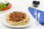 Spaghetti bolognese with salad — Stock Photo