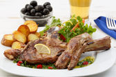 Beef chops with potatoes and salad — Stock Photo