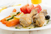 Roasted chicken legs with vegetables — Stock Photo