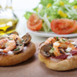 Small shrimp pizza with salad — Stock Photo
