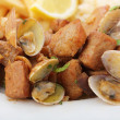 Traditional portuguese dish -clams with fried pork meat — Stock Photo