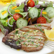Grilled tuna steak with garlic — Stock Photo