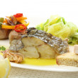 Roasted cod fish dish - Stock Photo