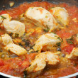 Stock Photo: Chicken white meat with tomato sauce being cooked