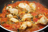 Chicken white meat with tomato sauce being cooked — Stock Photo