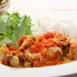 Stock Photo: Chiken white meat with tomato sauce on plate