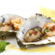Fried oysters and prawns in a shell isolated on white — Stock Photo