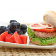 Stock Photo: Healthy low fat chicken burger with fruit isolated
