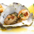 Stock Photo: Close up of fried oysters and shrimps in a shell isolated on whi