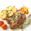 Stock Photo: Roasted pork with potatoes isolated on white