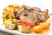 Roasted pork with potatoes isolated on white — Stock Photo