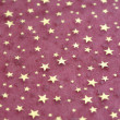 Fabric grunge christmas background with stars pattern — Stock Photo #37352355