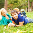 Father, mother and daughter in the park — Stock Photo