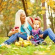 Parent and child - soft focus (focus on eyes of child) - Stock Photo