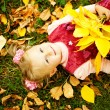 Little girl in autumn park (soft focus, focus on eyes of baby) - Stock Photo
