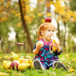 Little girl in autumn park (soft focus, focus on eyes of baby) — Stok fotoğraf