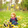 Royalty-Free Stock Photo: Little girl in autumn park (soft focus, focus on eyes of baby)