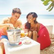 Young beautiful couple on the beach — Stock Photo