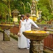 Traditional wedding in balinese temple - Stock Photo