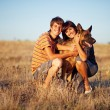 Mother with adult son and the dog — Stock Photo