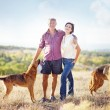 Man and woman in a field — Stock Photo