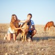 Brother and sister on a field — Stock Photo