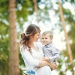 Family together in the summer park with a son — Stockfoto