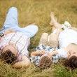 Family together in the summer park with a son — ストック写真