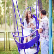 Family together in the summer park with a son — Stok fotoğraf