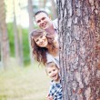 Foto Stock: Family together in the summer park with a son
