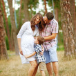 Family together in the summer park with a son — Stock Photo