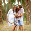 Family together in the summer park with a son — Stock fotografie