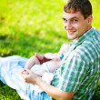 Young father with son outdoors in park - Stock Photo