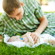 Young father with son outdoors in park — Stock Photo