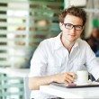 Man in cafe with coffee — Stockfoto